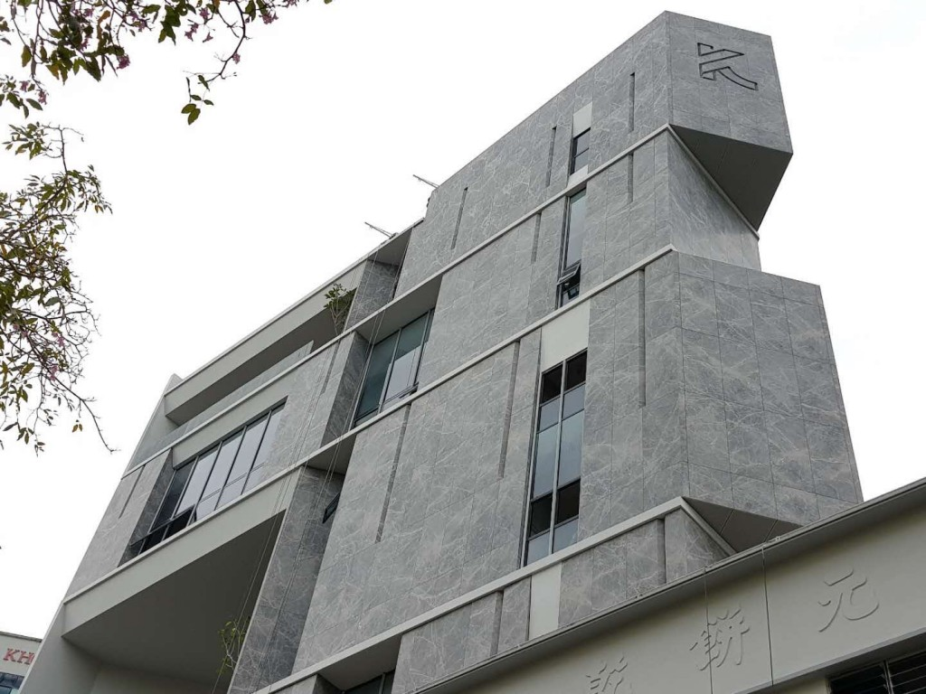 The Khong Guan Office Building in Singapore, featuring impressive exterior cladding courtesy of HyCOMB's honeycomb panels