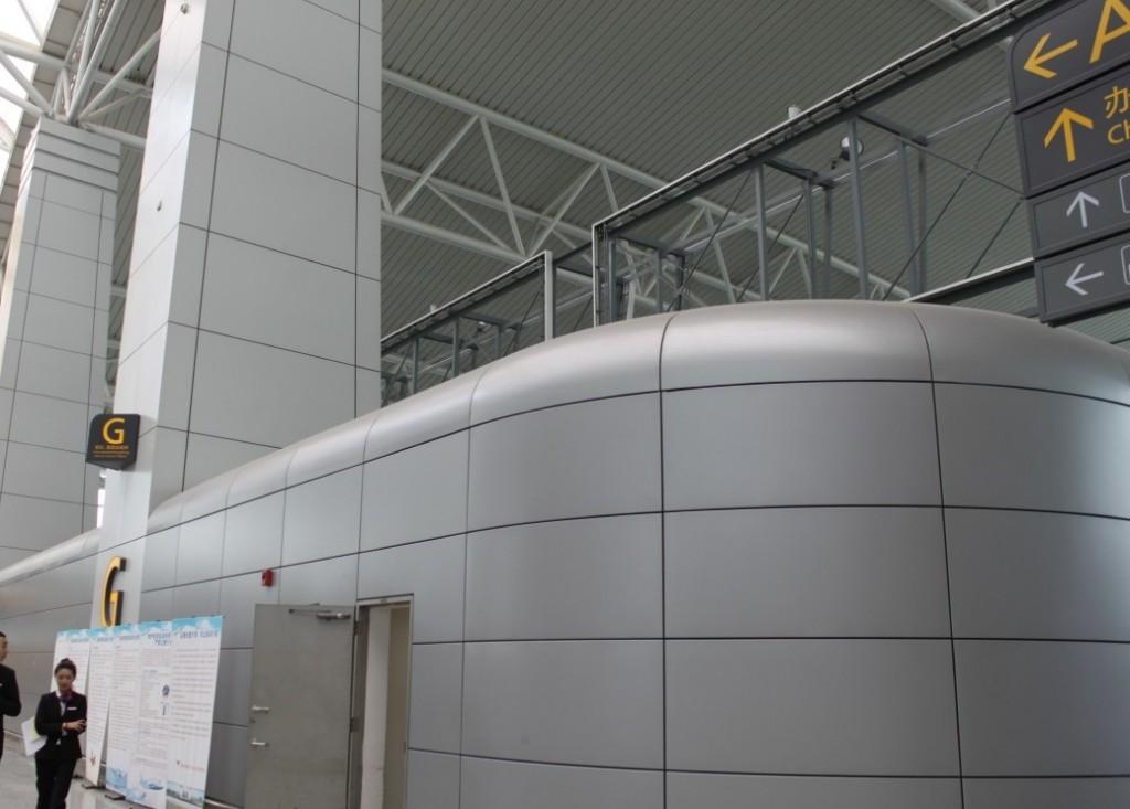 Guangzhou Baiyun International Airport's interior cladding with HyCOMB's stone & aluminium honeycomb panels - 3