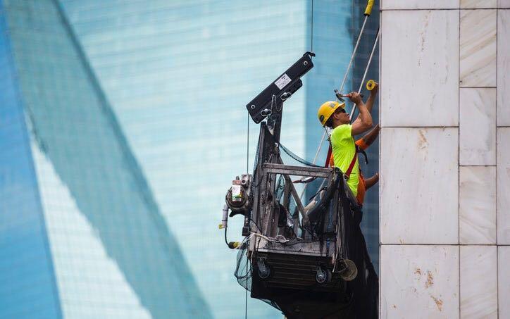 Honeycomb panel exterior cladding installation - 1401 Elm Street, Dallas