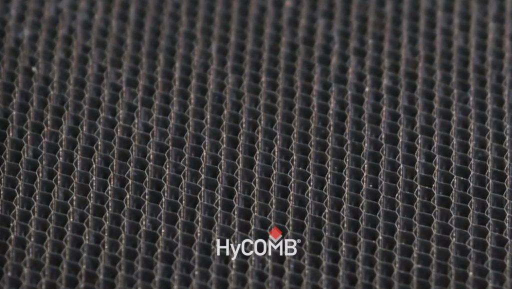 A honeycomb core panel with HyCOMB Pane;ls logo